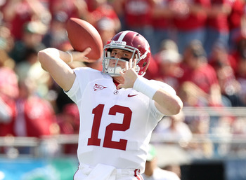 ORLANDO, FL - JANUARY 01:  Greg McElroy #12 of the Alabama Crimson Tide warms up during the Capitol One Bowl against the Michigan State Spartans at the Florida Citrus Bowl on January 1, 2011 in Orlando, Florida.  (Photo by Mike Ehrmann/Getty Images)