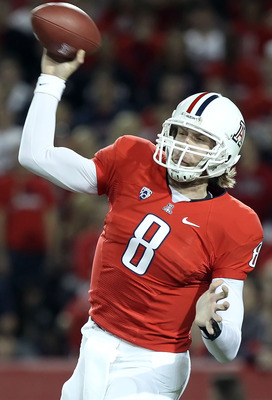 TUCSON, AZ - DECEMBER 02:  Quarterback Nick Foles #8 of the Arizona Wildcats throws a pass against the Arizona State Sun Devils during the college football game at Arizona Stadium on December 2, 2010 in Tucson, Arizona. The Sun Devils defeated the Wildcat