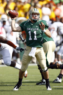 WACO, TX - NOVEMBER 14:  Quarterback Nick Florence #11 of the Baylor Bears drops back to pass during the first half against the Texas Longhorns on November 14, 2009 at Floyd Casey Stadium in Waco, Texas.  The Longhorns beat the Bears 47-14.  (Photo by Tom