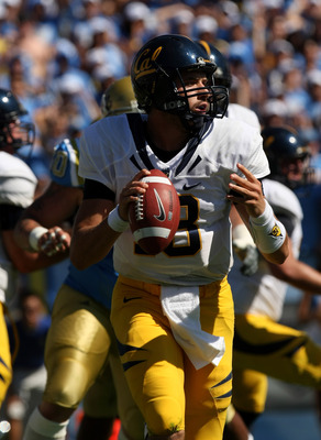 PASADENA, CA - OCTOBER 17: Quarterback Kevin Riley #13 of the California Golden Bears rolls out with the ball against the UCLA Bruins on October 17, 2009 at the Rose Bowl in Pasadena, California.   Cal won 45-26.  (Photo by Stephen Dunn/Getty Images)