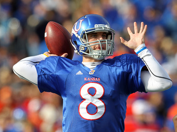 LAWRENCE, KS - NOVEMBER 20:  Quarterback Quinn Mecham #8 of the Kansas Jayhawks passes  during the game against the Oklahoma State Cowboys on November 20, 2010 at Memorial Stadium in Lawrence, Kansas.  (Photo by Jamie Squire/Getty Images)