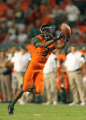 MIAMI - NOVEMBER 20:  Travis Benjamin #3 of the Miami Hurricanes misses a fingertip catch during a game against the Virginia Tech Hokies at Sun Life Stadium on November 20, 2010 in Miami, Florida.  (Photo by Mike Ehrmann/Getty Images)
