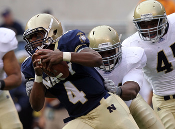 EAST RUTHERFORD, NJ - OCTOBER 23: Ricky Dobbs #4 of the Navy Midshipmen rushes with the ball against the Notre Dame Fighting Irish at New Meadowlands Stadium on October 23, 2010 in East Rutherford, New Jersey.  (Photo by Nick Laham/Getty Images)