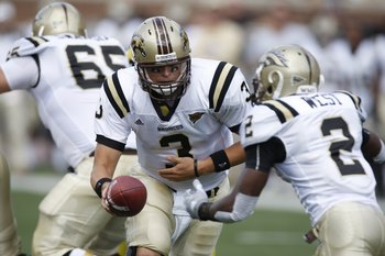 ANN ARBOR, MI - SEPTEMBER 5:  Tim Hiller #3 of the Western Michigan Broncos hands off to Brandon West #2 during the game against the Michigan Wolverines on September 5, 2009 at Michigan Stadium in Ann Arbor, Michigan. (Photo by Gregory Shamus/Getty Images