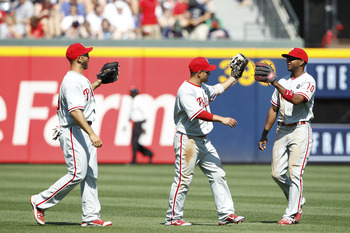 ATLANTA, GA - APRIL 10: Shane Victorino #8, Ben Francisco #10 and Raul Ibanez #29 of the Philadelphia Phillies celebrate after the game against the Atlanta Braves at Turner Field on April 10, 2011 in Atlanta, Georgia. The Phillies won 3-0. (Photo by Joe R