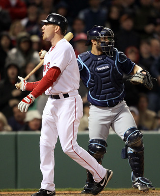 BOSTON, MA - APRIL 12:  J.D. Drew #7 of the Boston Red Sox reacts after he struck out in the bottom of the ninth inning as Kelly Shoppach #10 of the Tampa Bay Rays catches on April 12, 2011 at Fenway Park in Boston, Massachusetts. The Tampa Bay Rays defea