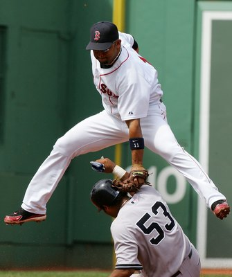 BOSTON - AUGUST 18:  Alex Gonzalez #11 of the Boston Red Sox is late with the tag as Bobby Abreu #53 of the New York Yankees safely steals second on August 18, 2006 at Fenway Park in Boston Massachusetts.  (Photo by Jim McIsaac/Getty Images)