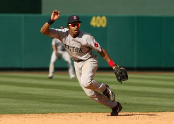 ANAHEIM, CA - MAY 14: Shortstop Julio Lugo #23 of the Boston Red Sox plays in the field against the Los Angeles Angels of Anaheim on May 14, 2009 at Angel Stadium in Anaheim, California.   The Angels won 5-4 in 12 innings.  (Photo by Stephen Dunn/Getty Im