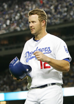 LOS ANGELES, CA - APRIL 25:  Jeff Kent #12 of the Los Angeles Dodgers returns to the dugout after scoring in the second inning against the Colorado Rockies at Dodger Stadium on April 25, 2008 in Los Angeles, California.  (Photo by Lisa Blumenfeld/Getty Im