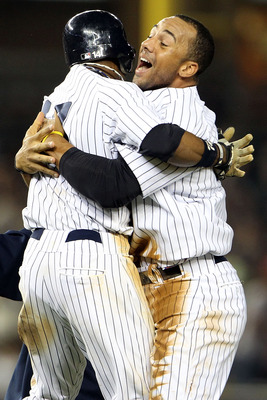 NEW YORK, NY - MAY 24:  Brett Gardner #11 and Chris Dickerson #27 of the New York Yankees celebrate after defeating the Toronto Blue Jays at Yankee Stadium on May 24, 2011 in the Bronx borough of New York City.  (Photo by Michael Heiman/Getty Images)