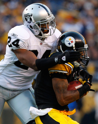 PITTSBURGH - NOVEMBER 21:  Mike Wallace #17 of the Pittsburgh Steelers makes a catch in front of Michael Huff #24 of the Oakland Raiders during the game on November 21, 2010 at Heinz Field in Pittsburgh, Pennsylvania.  (Photo by Jared Wickerham/Getty Imag