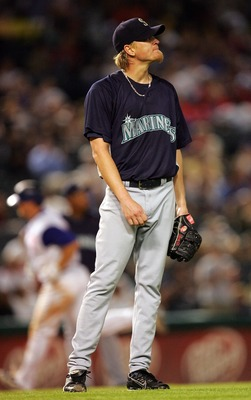 ARLINGTON, TX - AUGUST 23: Jeff Weaver #36 of the Seattle Mariners steps off the mound after Brad Wilkerson #6 of the Texas Rangers hit a two-run homerun on August 23, 2007 at Rangers Ballpark in Arlington, Texas.   (Photo by Ronald Martinez/Getty Images)