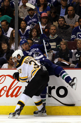VANCOUVER, BC - JUNE 01:  Patrice Bergeron #37 of the Boston Bruins checks Alex Burrows #14 of the Vancouver Canucks during game one of the 2011 NHL Stanley Cup Finals at Rogers Arena on June 1, 2011 in Vancouver, Canada.  (Photo by Bruce Bennett/Getty Im