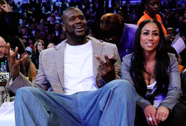 LOS ANGELES, CA - FEBRUARY 19:  Shaquille O'Neal of the Boston Celtics with girlfriend Nicole 'Hoopz' Alexander sit courtside as they attend NBA All-Star Saturday night presented by State Farm at Staples Center on February 19, 2011 in Los Angeles, Califor