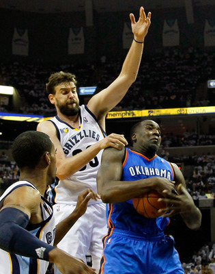 MEMPHIS, TN - MAY 13:  Kendrick Perkins #5 of the Oklahoma City Thunder grabs a rebound against Marc Gasol #33 and Mike Conley #11 of the Memphis Grizzlies in Game Six of the Western Conference Semifinals in the 2011 NBA Playoffs at FedExForum on May 13,