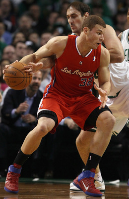 BOSTON, MA - MARCH 09:  Blake Griffin #32 of the Los Angeles Clippers tries to keep the ball from Nenad Krstic #4 of the Boston Celtics on March 9, 2011 at the TD Garden in Boston, Massachusetts. NOTE TO USER: User expressly acknowledges and agrees that,