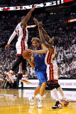 MIAMI, FL - JUNE 02:  Dirk Nowitzki #41 of the Dallas Mavericks drives against Udonis Haslem #40 and Dwyane Wade #3 of the Miami Heat in Game Two of the 2011 NBA Finals at American Airlines Arena on June 2, 2011 in Miami, Florida. NOTE TO USER: User expre
