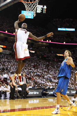 MIAMI, FL - JUNE 02:  LeBron James #6 of the Miami Heat dunks the ball in the third quarter in front of Dirk Nowitzki #41 of the Dallas Mavericks in Game Two of the 2011 NBA Finals at American Airlines Arena on June 2, 2011 in Miami, Florida. NOTE TO USER