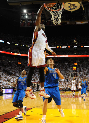 MIAMI, FL - JUNE 02:  Dwyane Wade #3 of the Miami Heat dunks against Dirk Nowitzki #41 of the Dallas Mavericks in Game Two of the 2011 NBA Finals at American Airlines Arena on June 2, 2011 in Miami, Florida. The Mavericks won 95-93. NOTE TO USER: User exp