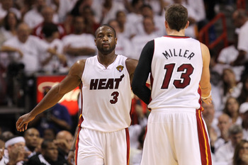 MIAMI, FL - JUNE 02:  Dwyane Wade #3 of the Miami Heat reacts alongside teammate Mike Miller #13 in the second quarter against the Dallas Mavericks in Game Two of the 2011 NBA Finals at American Airlines Arena on June 2, 2011 in Miami, Florida. NOTE TO US
