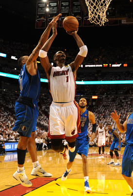 MIAMI, FL - JUNE 02:  Chris Bosh #1 of the Miami Heat attempts a shot against Shawn Marion #0 of the Dallas Mavericks in Game Two of the 2011 NBA Finals at American Airlines Arena on June 2, 2011 in Miami, Florida. The Mavericks won 95-93. NOTE TO USER: U