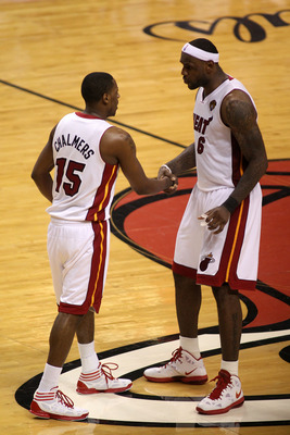 MIAMI, FL - JUNE 02:   LeBron James #6 (R) of the Miami Heat talks with Mario Chalmers #15 against the Dallas Mavericks in Game Two of the 2011 NBA Finals at American Airlines Arena on June 2, 2011 in Miami, Florida. NOTE TO USER: User expressly acknowled