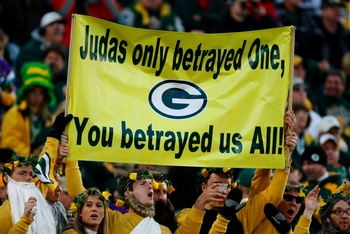 GREEN BAY, WI - NOVEMBER 01:  Fans hold a sign referring to quarterback Brett Favre #4 of the Minnesota Vikings during the game against the Green Bay Packers at Lambeau Field on November 1, 2009 in Green Bay, Wisconsin. (Photo by Scott Boehm/Getty Images)