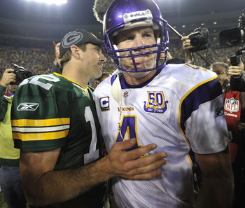 GREEN BAY, WI - OCTOBER 24: Aaron Rodgers #12 of the Green Bay Packers meets with Brett Favre #4 of the Minnesota Vikings after the Packers defeated the Vikings 28-24 at Lambeau Field on October 24, 2010 in Green Bay, Wisconsin. (Photo by Jim Prisching/Ge