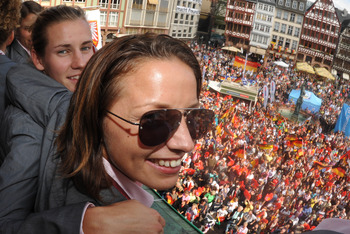 FRANKFURT AM MAIN, GERMANY - SEPTEMBER 11: (L-R) Simone Laudehr and Inka Grings celebrate during a reception for the German women's national team on the balcony of the city hall 'Roemer' on September 11, 2009 in Frankfurt am Main, Germany.  (Photo by Bori