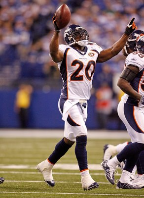 INDIANAPOLIS - DECEMBER 13:  Brian Dawkins #20 of the Denver Broncos celebrates after intercepting a pass during the NFL game against the Indianapolis Colts at Lucas Oil Stadium on December 13, 2009 in Indianapolis, Indiana.  The Colts won 28-16.  (Photo