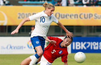 SUWON, SOUTH KOREA - OCTOBER 19:  Kelly Smith of England and Hong Kyung-Suk of South Korea compete for the ball during the Peace Queen Cup match between South Korea and England at Suwon World Cup Stadium on October 19, 2010 in Suwon, South Korea.  (Photo