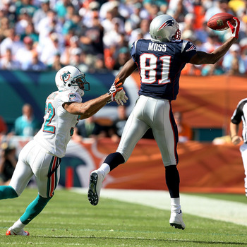 MIAMI - NOVEMBER 23: Wide receiver Randy Moss #81 of the New England Patriots pulls in a one-handed catch over cornerback Jason Allen #32 of the Miami Dolphins at Dolphin Stadium on November 23, 2008 in Miami, Florida.  (Photo by Doug Benc/Getty Images)