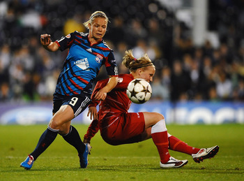 LONDON, ENGLAND - MAY 26:  Eugenie Le Sommer of Lyon battles with Tabea Kemme of Turbine Potsdam during the UEFA Women's Champions League Final between Lyon and Turbine Potsdam at Craven Cottage on May 26, 2011 in London, England.  (Photo by Laurence Grif