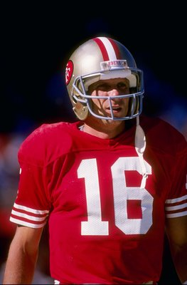 Quarterback Joe Montana of the San Francisco 49ers stands on the field during a game against the Los Angeles Rams at Candlestick Park in San Francisco, California. The Rams won the game 13-12.