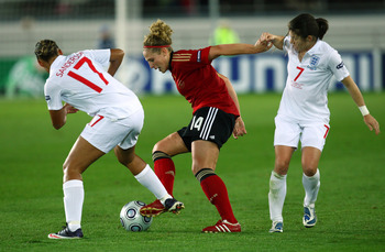 HELSINKI, FINLAND - SEPTEMBER 10:  Karen Carney (R) of England tries to tackle Kim Kulig of Germany during the UEFA Women's Euro 2009 Final match between England and Germany at the Helsinki Olympic Stadium on September 10, 2009 in Helsinki, Finland.  (Pho