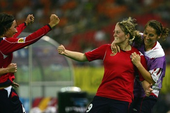 HANGZHOU, ZHEJIANG - SEPTEMBER 20:  Isabell Herlovsen (R 9#) of Norway celebrates a goal with her teammates during the FIFA Women's World Cup 2007 Group C match between Norway and Ghana at Hangzhou Dragon Stadium on September 20, 2007 in Hangzhou, Zhejian
