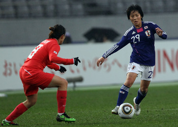 TOKYO - FEBRUARY 13:  Mana Iwabuchi of Japan and Kye Lim Lee of South Korea compete for the ball during the East Asian Football Federation (EAFF) Women's Championship 2010 match between Japan and South Korea at Ajinomoto Stadium on February 13, 2010 in To