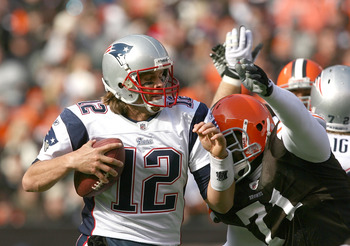 CLEVELAND - NOVEMBER 07:  Quarterback Tom Brady #12 of the New England Patriots is sacked by defensive lineman Ahtyba Rubin #71 of the Cleveland Browns at Cleveland Browns Stadium on November 7, 2010 in Cleveland, Ohio.  (Photo by Matt Sullivan/Getty Imag