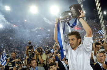 ATHENS, GREECE - JULY 5:  Greek national team captain Theodoros Zagorakis raises the trophy during a victory fiesta on July 5, 2004 at Panathenaic Stadium in Athens, Greece. Thousands of Greeks welcomed the new UEFA Euro 2004 Champions upon their arrival