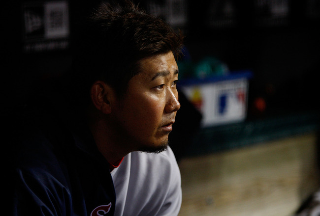 CLEVELAND - APRIL 06:  Daisuke Matsuzaka #18 of the Boston Red Sox sits in the dugout during the game against the Cleveland Indians on April 6, 2011 at Progressive Field in Cleveland, Ohio.  (Photo by Jared Wickerham/Getty Images)
