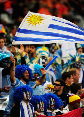CAPE TOWN, SOUTH AFRICA - JULY 06:  Uruguay fans enjoy the atmosphere prior to the 2010 FIFA World Cup South Africa Semi Final match between Uruguay and the Netherlands at Green Point Stadium on July 6, 2010 in Cape Town, South Africa.  (Photo by Jamie Mc
