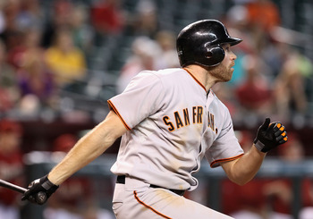 Nate Schierholtz hit a game-tying single with two outs in the ninth, and then a single to put San Francisco ahead in the 11th against St. Louis Wednesday night