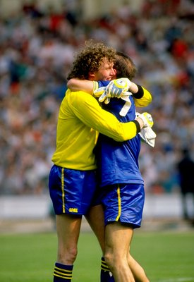 16 May 1988:  Wimbledon goalkeeper David Beasant and team mate Alan Cork celebrate after their victory in the FA Cup Final match against Liverpool played at Wembley Stadium in London, England.  Wimbledon won the match 1-0. \ Mandatory Credit: Allsport UK/