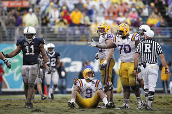 ORLANDO, FL - JANUARY 1: Jordan Jefferson #9 of the LSU Tigers lobbies for a late hit after being hit by Navorro Bowman #11 of the Penn State Nittany Lions during the 2010 Capital One Bowl at the Florida Citrus Bowl Stadium on January 1, 2010 in Orlando,