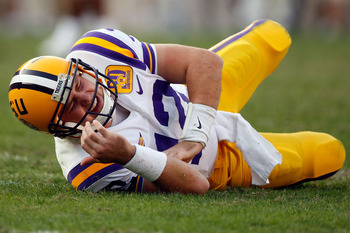 BATON ROUGE, LA - NOVEMBER 22:  Quarterback Jarrett Lee #12 of the Louisiana State University Tigers lies on the ground after suffering an injury while playing the Ole Miss Rebels on November 22, 2008 at Tiger Stadium in Baton Rouge, Louisiana. Lee did no