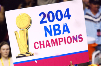 AUBURN HILLS, MI - JUNE 15:  Rasheed Wallace #30 of the Detroit Pistons celebrates with a sign after defeating the Los Angeles Lakers 100-87 in game five of the 2004 NBA Finals on June 15, 2004 at The Palace of Auburn Hills in Auburn Hills, Michigan.  NOT