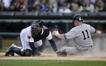 DETROIT, MI - MAY 02:  Brett Gardner #11 of the New York Yankees scores a run past Alex Avila #13 of the Detroit Tigers during the second inning at Comerica Park on May 2, 2011 in Detroit, Michigan.  (Photo by Gregory Shamus/Getty Images)