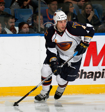UNIONDALE, NY - MARCH 24:  Zach Bogosian #4 of the Atlanta Thrashers skates during an NHL hockey game against the New York Islanders at the Nassau Coliseum on March 24, 2011 in Uniondale, New York.  (Photo by Paul Bereswill/Getty Images)