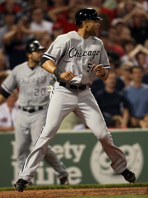 BOSTON, MA - MAY 30:  Alex Rios #51 of the Chicago White Sox scores a run in the sixth inning against the Boston Red Sox on May 30, 2011 at Fenway Park in Boston, Massachusetts.  (Photo by Elsa/Getty Images)