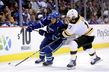 VANCOUVER, BC - JUNE 01:  Kevin Bieksa #3 of the Vancouver Canucks skates against Milan Lucic #17 of the Boston Bruins during game one of the 2011 NHL Stanley Cup Finals at Rogers Arena on June 1, 2011 in Vancouver, Canada.  (Photo by Harry How/Getty Imag